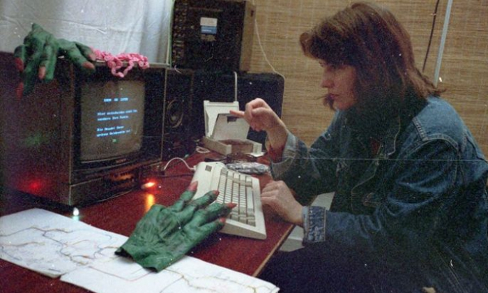 Ásdis Thoroddsen (dffb class of 1983) with a selection screen from Mutabor III/Videolabyrinth, playing during VideoFest 1988 at MedienOperative, Potsdamer Str. 96. Photo: Friederike Anders.
