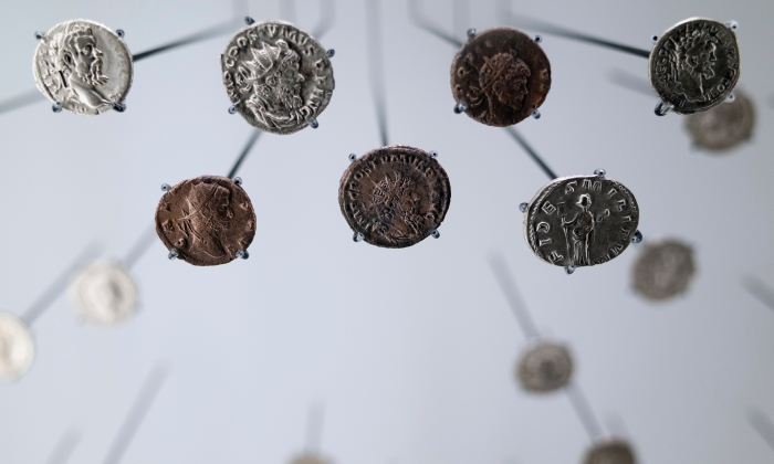 Roman coins. Photo by Nikita Andreev on Unsplash